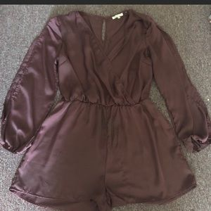 Purple Charlotte Russe long sleeve satin romper